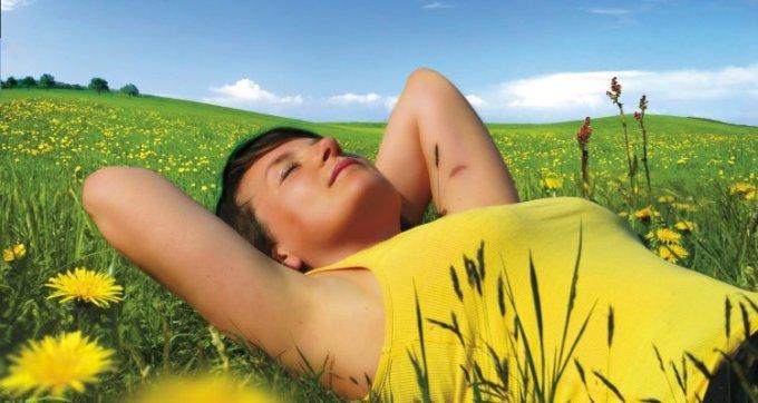 alone-time_OMTimes_bigstock-girl-lying-in-a-meadow-enjoyin-22220615