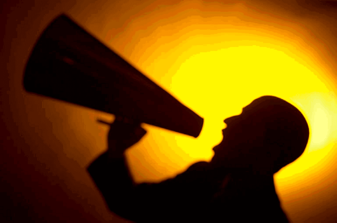 Silhouette of man yelling into a bullhorn uid 2